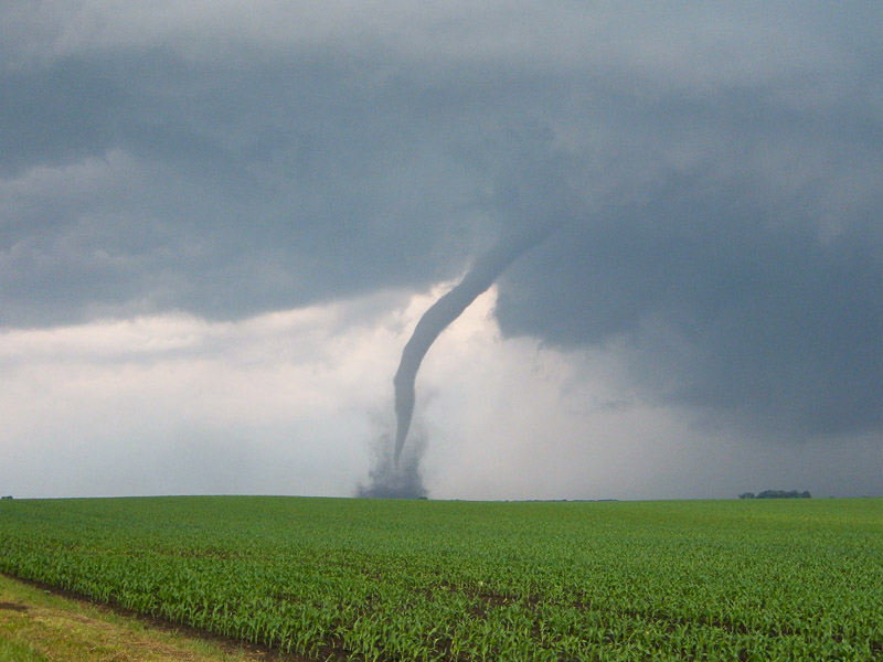 A condensation funnel is made up of water droplets and extends downward from the base of the thunderstorm. If it is In contact with the ground it is a tornado; otherwise it is a funnel cloud. Dust and debris beneath the condensation funnel confirm a tornado's presence. (photo NSSL / NOAA)