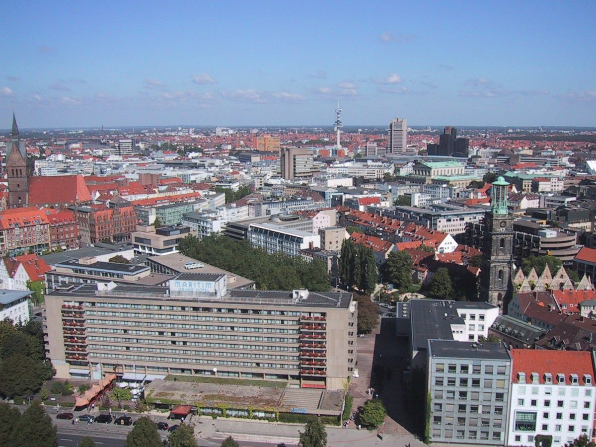Hannover Aerial View: The skyline of Hannover as seen from the top of the New Town hall. The Aegidienkirche can be seen on the right, the Opera house is the green roofed greek style building on the right [photo: Chris 73 / Creative Commons Attribution-Share Alike 3.0 Unported CC BY-SA 3.0]